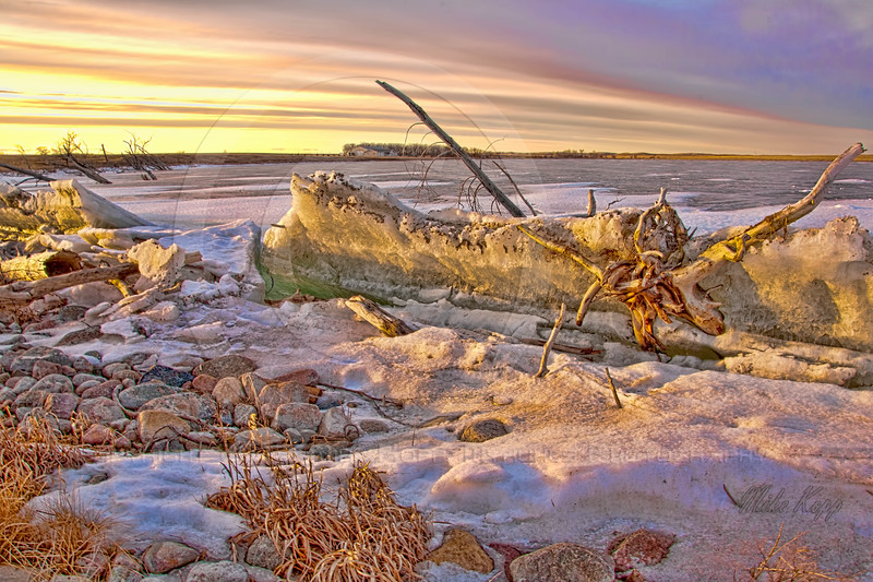 Again, ice chunks piled up along Highway 36 near Pettibone and Woodworth, ND. Golden hour in the evening ads more color than you might expect.