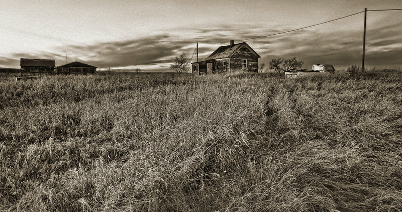 This lonely abandoned farm house in Oliver County, North Dakota prompts an erie and forlorn feeling. The tire tracks through the tall grass, the aged home.  You can almost imagine the family that grew up here and now lives somewhere else.