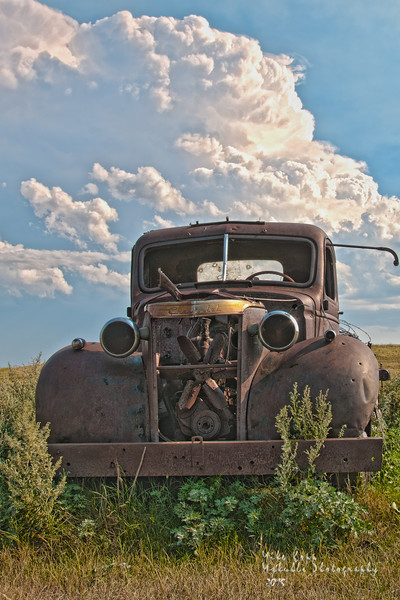 Abandoned Chevy farm truck and storm clouds