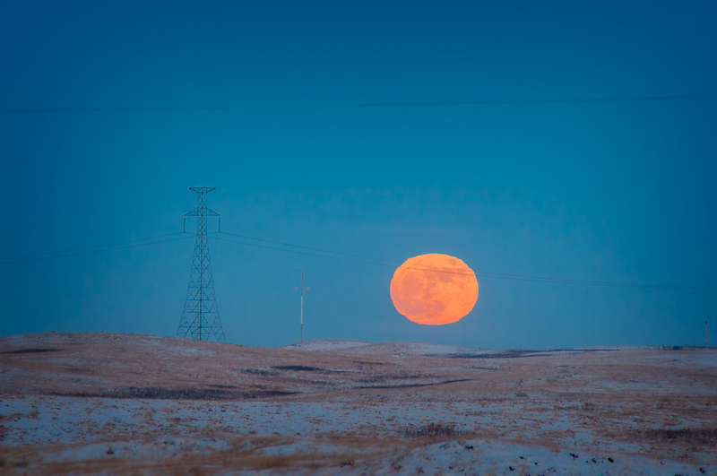 Full moon under the power lines