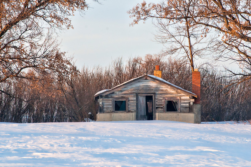 abandoned cabin in the winter sun