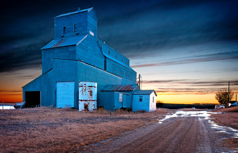 Until about 1985, this was a thriving local grain elevator. Then Burlington Northern decided to abandoned the line and this empty grain elevator remains at Lake Williams. Unlike the B&W image next door, this one accentuates the color of the sunset, the reason I stopped to take this photo in the first place.