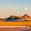 """Brightly lit, the setting sun creates a golden hour as the moon rises over the hills in Stark County.<br /> <br /> You can own this image or others here on Mykuhls.com.  Wanna browse at the products offered?  Click """"buy"""" then sit back and do your shopping."""