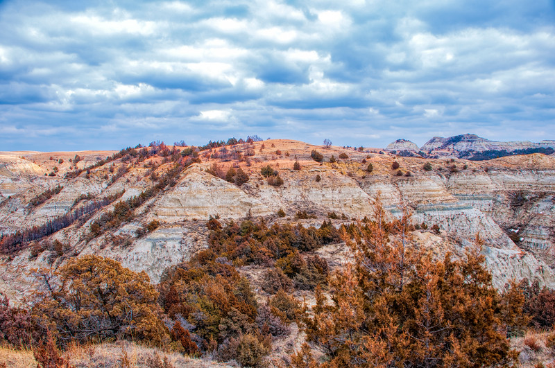 """Even on cloudy days, the colors of the Badlands are impressive.<br /> <br /> You can own this image. Click """"buy"""" to see the options from wall prints to coffee mugs."""