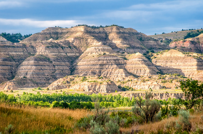 On the south side of the Little Missouri River is the Long X trail and the CCC Campground.  From there, looking north is the Theodore Roosevelt National Park.  In this canyon, you can find cannonball concretions and good hiking opportunities.