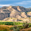 """On the south side of the Little Missouri River is the Long X trail and the CCC Campground.  From there, looking north is the Theodore Roosevelt National Park.  In this canyon, you can find cannonball concretions and good hiking opportunities.<br /> <br /> You can own this image as wall decor or other quality products from leading photo labs. Just click """"buy."""""""
