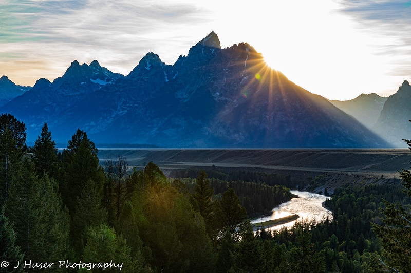 Sunburst behind Teton mountains