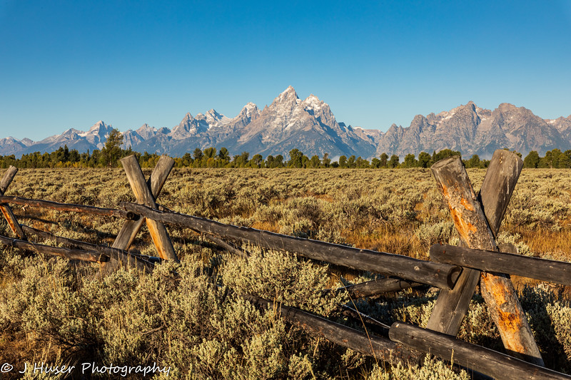 Split rail fence in front of Teton mountains