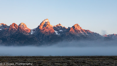 Dawn alpenglow on the Teton mountains