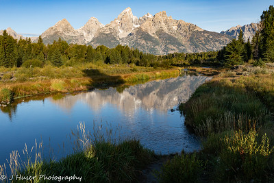 Teton mountain reflections in morning light