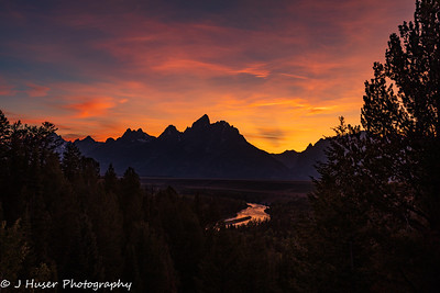 Colorful sunset behind the Teton mountains