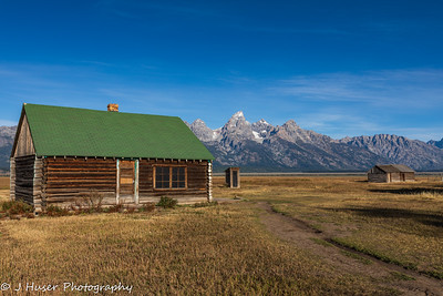 Log cabins and Teton Mountains