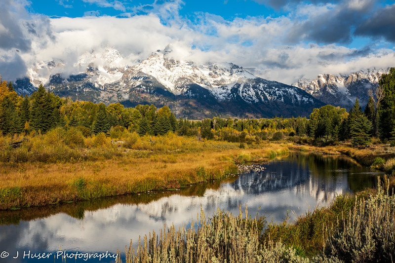 Reflections of snow covered mountains