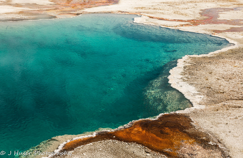 Colorful pool of steaming water in Yellowstone NP