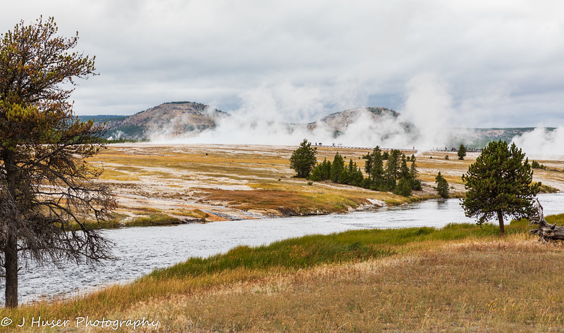 People in steam along Madison river in Yellowstone NP