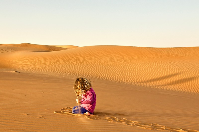 A child sifts sands. United Arab Emirates 2015.