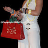 Model and red handbag at the Outre Hair Show Houston, Teas