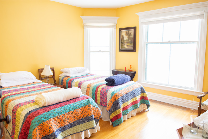 Maplewood<br /> Rates: <br /> Single Occupancy: $90.00<br /> Double Occupancy:  $100<br /> Additional Guest:  $15.00 on cot<br /> Check in: 5:15 pm or by special arrangement<br /> Check out: 11:00 am<br /> Second Story room<br /> Two extra long twin beds/King bed if attached together<br /> Luggage stands<br /> Air conditioner or screen<br /> Heating<br /> Table & Chairs<br /> Easy Chair<br /> Shared bathroom<br /> Breakfast INCLUDED<br /> NYS Sales Tax and Bed Tax not included