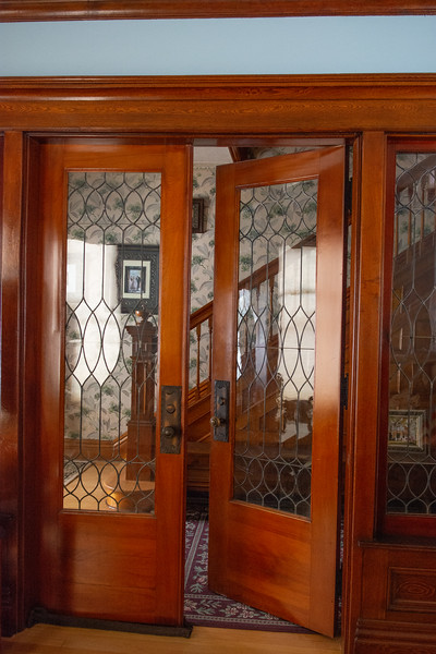 Lead glass doors from the entry to the living room.