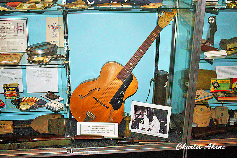 This guitar belonged to PFC Jack Gilbert Powers.