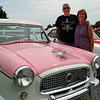 Nice couple next to a classic car