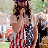 Stacey Osborne tells jokes for the talent portion of the Corn Fed King Pageant at the Beecher City Corn Festival Saturday evening. Kaitlin Cordes photo