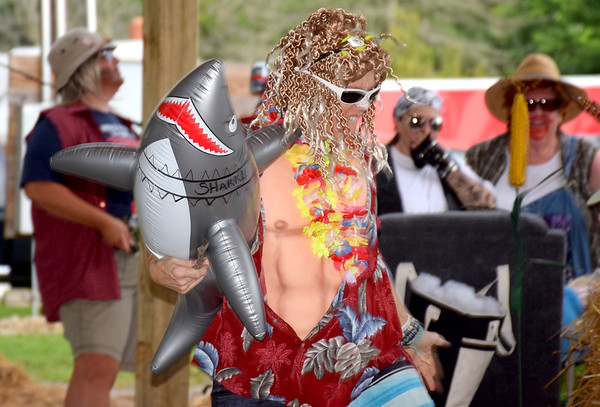 Stacy Heiserman, dressed as Johnny Tsunami, dances during the talent portion of the Corn Fed King Contest Saturday evening. Heiserman was later crowned the Corn Fest King. Kaitlin Cordes photo