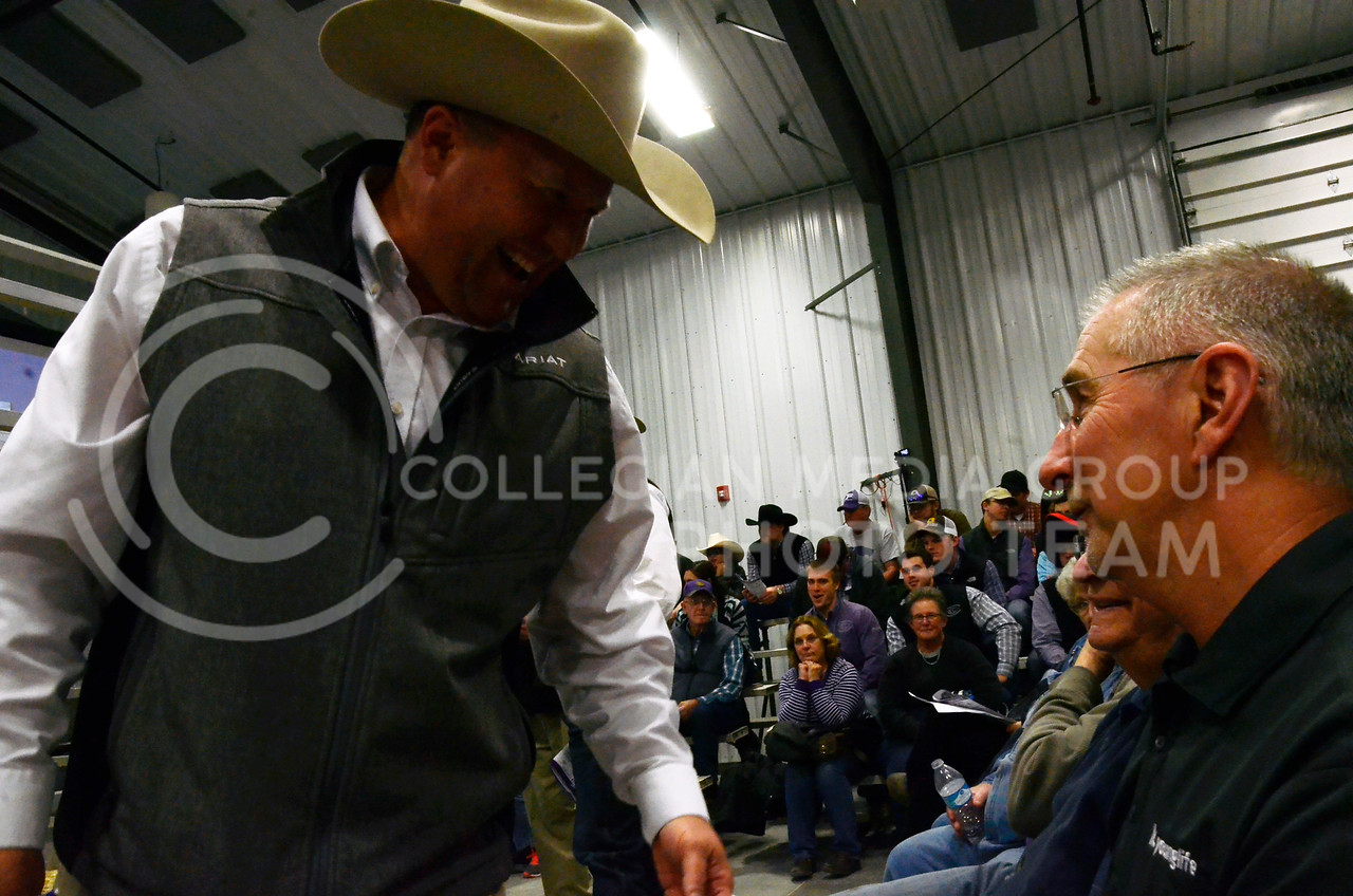 Attendees talk with workers as cattle are shown at Cattlemen's Day on Friday, March 2, 2018, at Stanley Stout Center, 2200 Denison Ave.