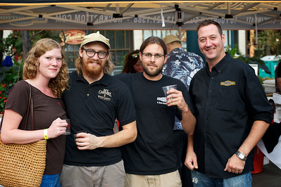 Cait, Jared from Mt Carmel Brewing, and Mitch and Dave from Rock Bottom Brewery at Cincy Beerfest on Fountain Square Friday