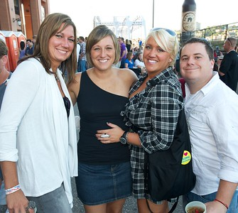 Stephanie Rip from N.KY, Elizabeth Racker of IN, Tiffany Daigle of Cincinnati and Mark Clayton from N.KY at the fireworks party on the Purple People Bridge