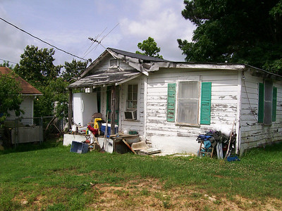 Before: This is the home in which Minnie Hawkins lived before a new one was constructed in Minden, La.