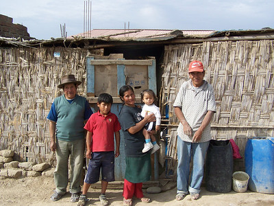 Before: Family living in a shack in La Florida, Peru.