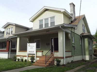 After: This home in Louisville sat vacant and boarded-up for a year before The Fuller Center made it a home for two-time cancer survivor Carolyn Mayes through the Save a House/Make a Home initiative.