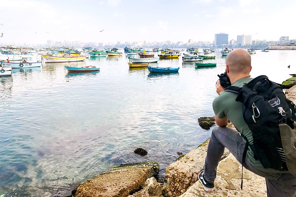 Photographer Aaron Northcott Capturing an Image Across the Port of Alexandria in Egypt
