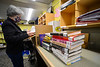 Leslie Markey, a cataloguer for the Brooks Memorial Library, in Brattleboro, Vt., organizes new books that came into the library on Friday, March 19, 2021. Even with the library closed to the general public, many of the day-to-day operations are still happening.