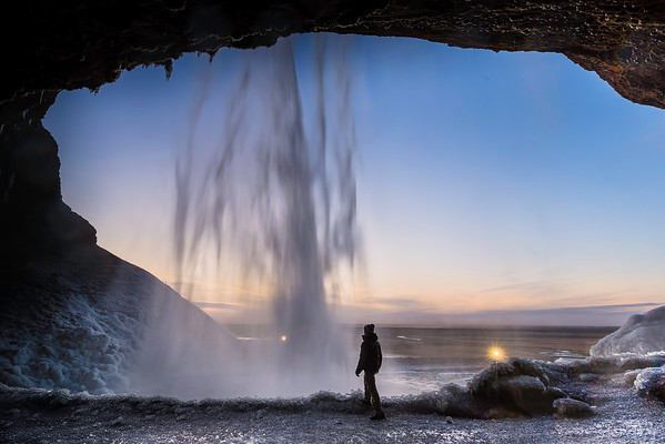 Walk behind a beautiful waterfall in South-Iceland