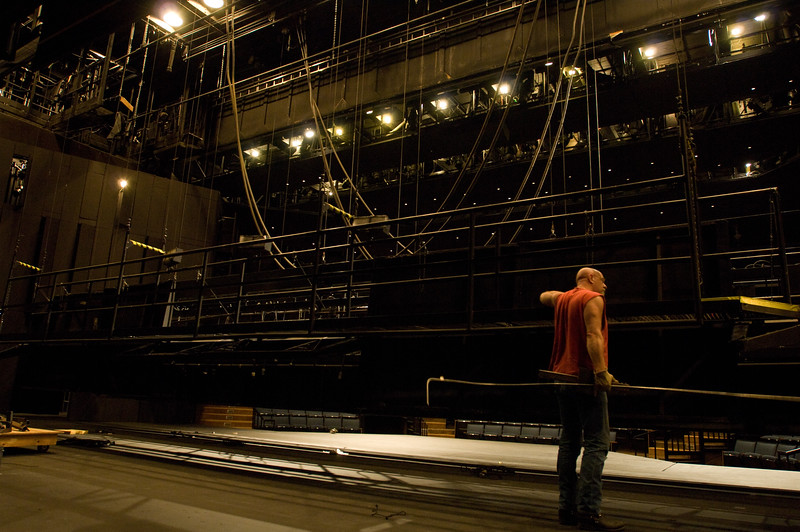 The Oregon Shakespeare Festival. 2008-09. Thomas Curtis cleaning the catwalks. Photo: Jenny Graham.