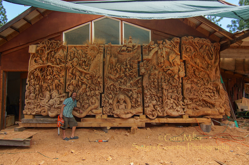 """""""The  Rendering of Mayan Creation Epic and Judgment Day"""" - A Mayan Masterpiece in the process of coming to life under the hands of master chainsaw artist J. Chester Armstrong. July 20, 2012 - Gary N. Miller - Sisters Country Photography"""