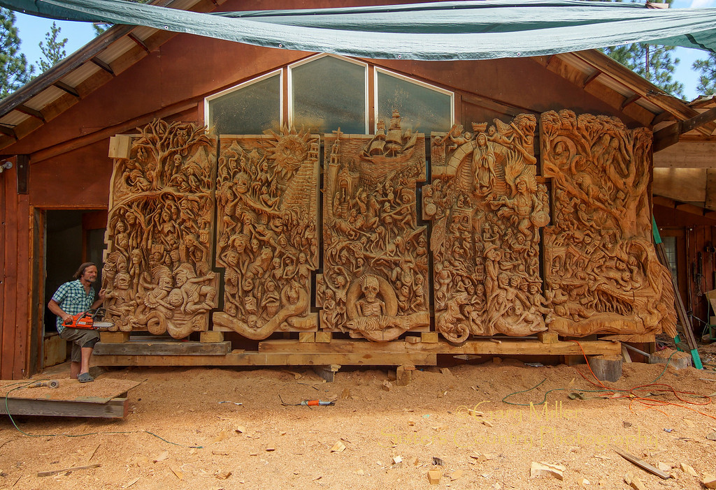 """""""The  Rendering of Mayan Creation Epic and Judgment Day"""" - A masterpiece in the process of coming to life under the incredible touch of master chainsaw sculpture artist J. Chester Armstrong. July 20, 2012 - Gary N. Miller - Sisters Country Photography"""