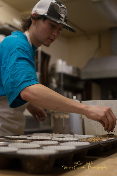 4:00 AM starts the day for 21 year old baker Taylor Lynch who has one week under his belt at his new job baking up Marionberry and other delicious muffins at Melissa Ward's well known Sisters Bakery in Sisters, Oregon. Image taken as part of Project Dayshoot+30, #dayshoot30, for the Oregon Historical Society - Copyright © 2013 Gary N. Miller, Sisters Country Photography