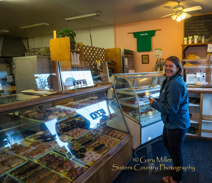 6:45 AM finds Sweet Home USFS District Ranger Cindy Glick buying bakery goodies at Sisters Bakery in Sisters, Oregon. Cindy is bringing the sweets to her daughter Rickie Glick's Youth Conservation Corps 7:00 AM meetup of the crew she supervises. Daughter Rickie is a proud second generation USFS employee working out of the Sisters Ranger District where Cindy got her career start, Image taken as part of Project Dayshoot+30, #dayshoot30, for the Oregon Historical Society - Copyright © 2013 Gary N. Miller, Sisters Country Photography