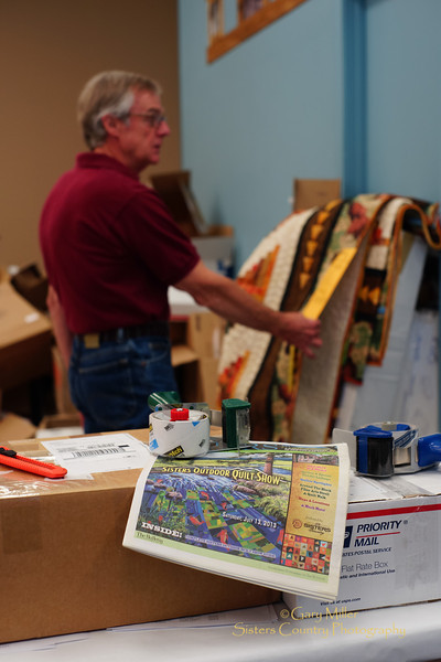 Monday July 15th in Sisters, Oregon, following the wrap-up of the Sisters Outdoor Quilt Show weekend, finds volunteers still hard at work with the monumental task of returning -- by hand or by by post -- to the proper owners all of the 1,400 quilts that participate in the largest outdoor quilt show in the world. Image taken as part of Project Dayshoot+30, #dayshoot30, for the Oregon Historical Society - Copyright © 2013 Gary N. Miller, Sisters Country Photography