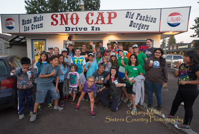 Eating home made ice cream at the Sno Cap is part of the joys for inner city youth enjoying their first outdoors experience during a week at Camp Tamarack outside of Sisters, Oregon. This Image was taken as part of Project Dayshoot+30, #dayshoot30, for the Oregon Historical Society on July 15, 2013 - Copyright © 2013 Gary N. Miller, Sisters Country Photography