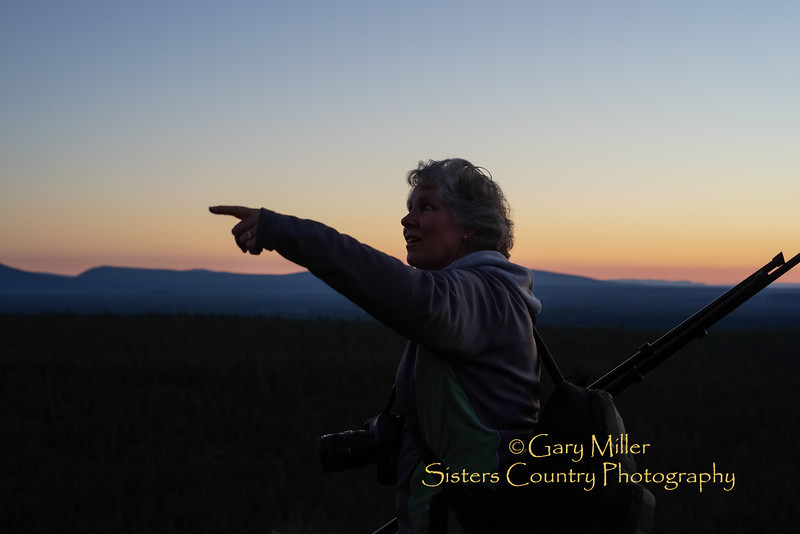 Fellow photographer Val Saiki accompanied Dayshoot30 photographer Gary N. Miller on a climb up Rooster Rock south of Sisters, Oregon to catch the sun rising over the Three Sisters in the Central Oregon Cascades on July 15th 2013. Image taken as part of Project Dayshoot+30, #dayshoot30, for the Oregon Historical Society - Copyright © 2013 Gary N. Miller, Sisters Country Photography