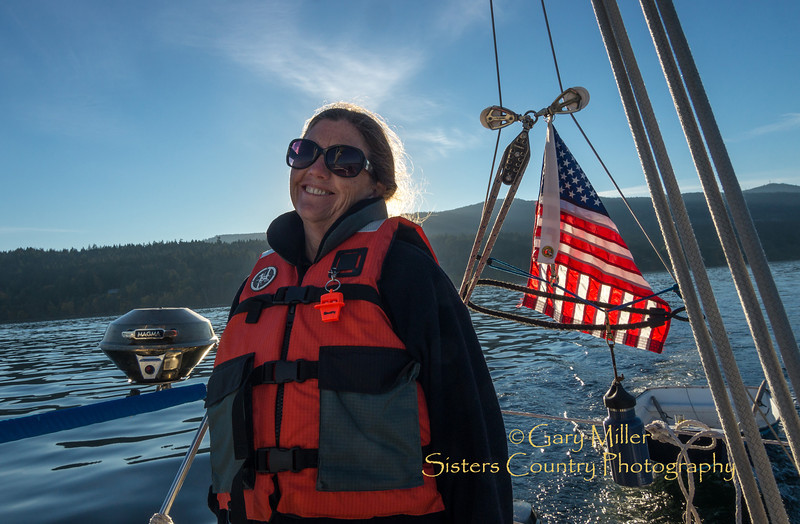 Beckie Zimmerman at the helm of White Rabbit off Saltspring Island. Images from a sailing holiday to the Canadian Gulf Islands in October of 2012 - Gary N. Miller - Sisters Country Photography