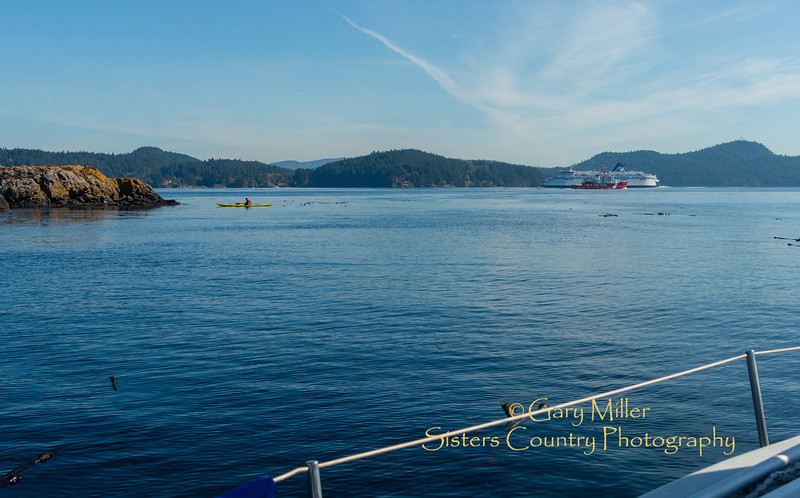 Vessels of all types went by as we were anchored for lunch off the SW end of Prevost Island. Images from a sailing holiday to the Canadian Gulf Islands in October of 2012 - Gary N. Miller - Sisters Country Photography