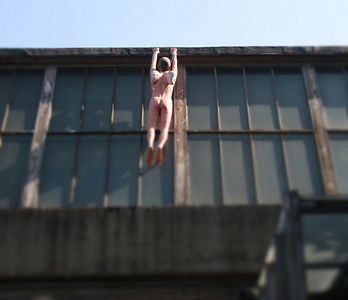 798 Art District Hanging Man Beijing © Lewis Sandler Beijing Video Studio 2009