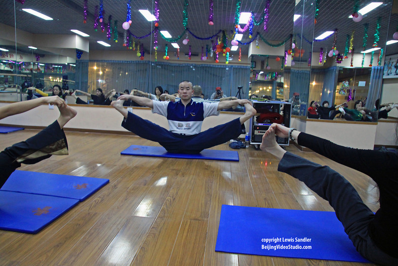 Yoga teacher Wei Bo Center, 2010 © Lewis Sandler Beijing Video Studio