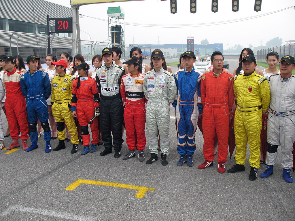 Beijing GoldenPort F3 Race drivers posing  before the race. Mandy Zhu 4th driver from the left in red suit is the only female driver. © Lewis Sandler Beijing Video Studio 2006
