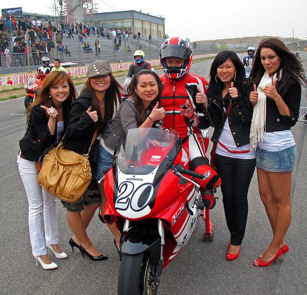 Motorcycle race with Fans, Beijing Goldenport Track 2007 © Lewis Sandler Beijing Video Studio